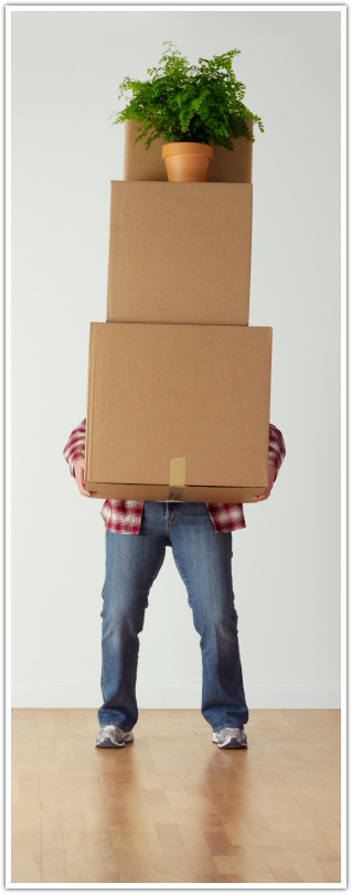 Man holding self storage boxes